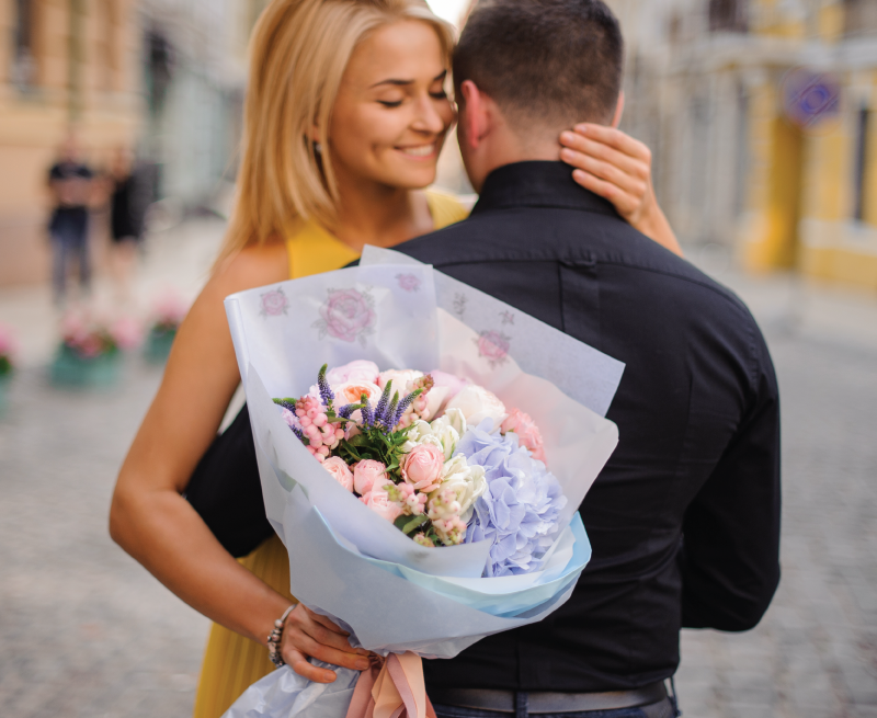 Girl holding large beautiful floral wrap